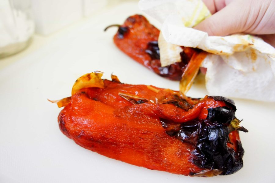 Peeling roasted red bell peppers with a paper towel