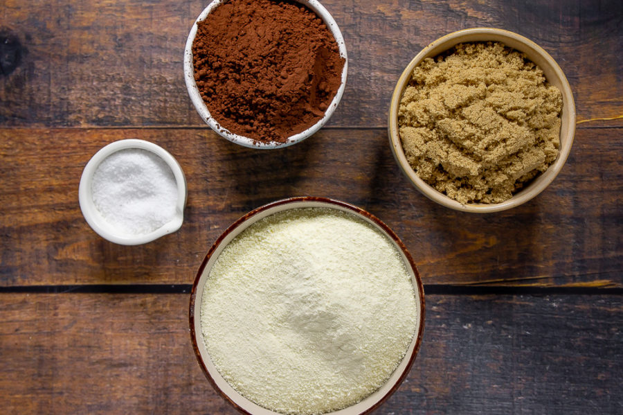 Ingredients for Homemade Hot Cocoa Mix - brown sugar, cocoa powder, dried milk, and salt