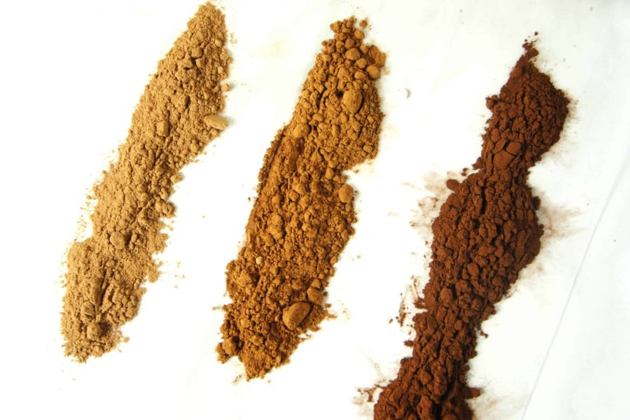 three lines of cocoa powder, from light brown to dark brown