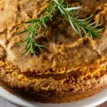 rosemary olive oil cake on a cake stand