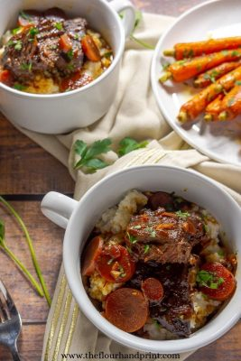 two bowls of braised beef with a side of carrots