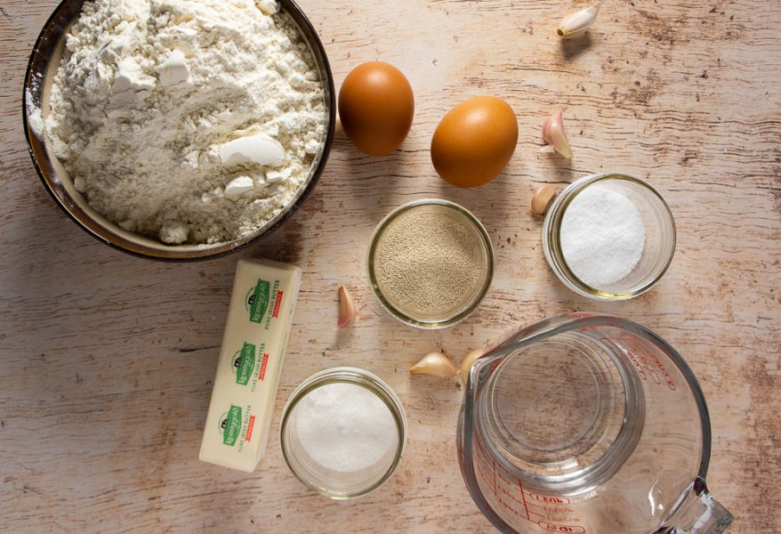 bowl of flour, eggs, water, yeast, butter, salt, and sugar