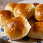 a plate of bread rolls