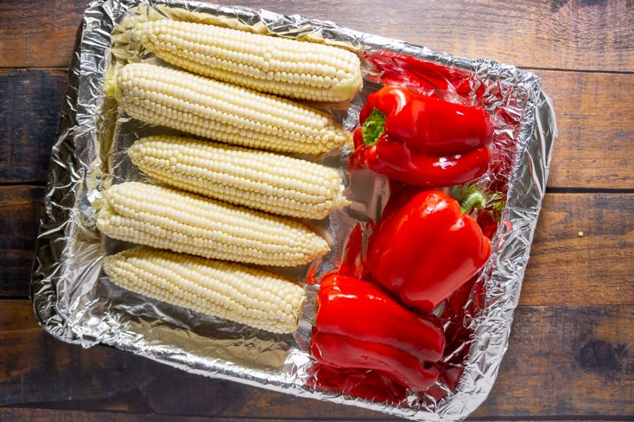 corn and red peppers on a pan