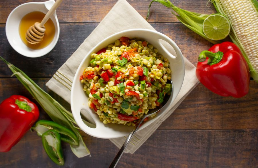 Avocado Corn salad with roasted red peppers in a bowl