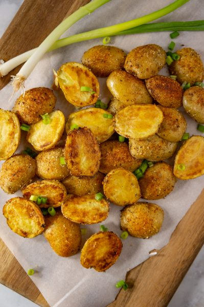 platter of roasted potatoes with green onions
