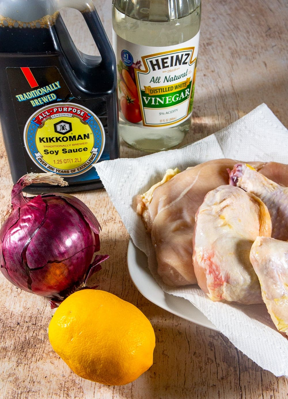 a lemon, onion, soy sauce, and white vinegar with chicken