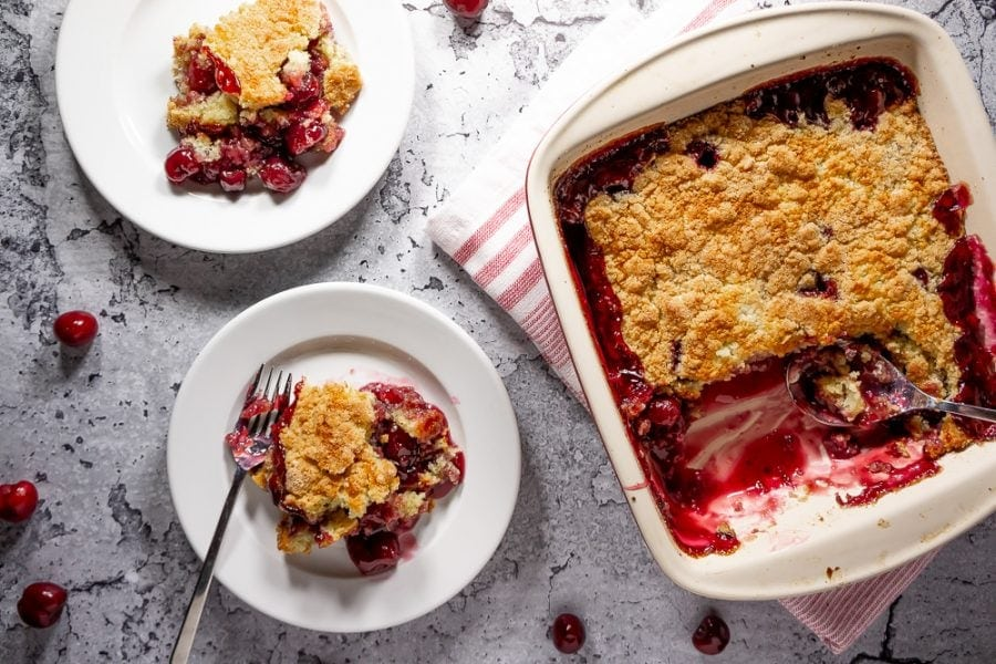 two plates of cherry cobbler
