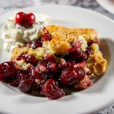 cherry cobbler with whipped cream