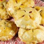 plate full of mini peach pies