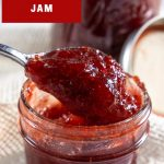 homemade strawberry jam dropping from spoon
