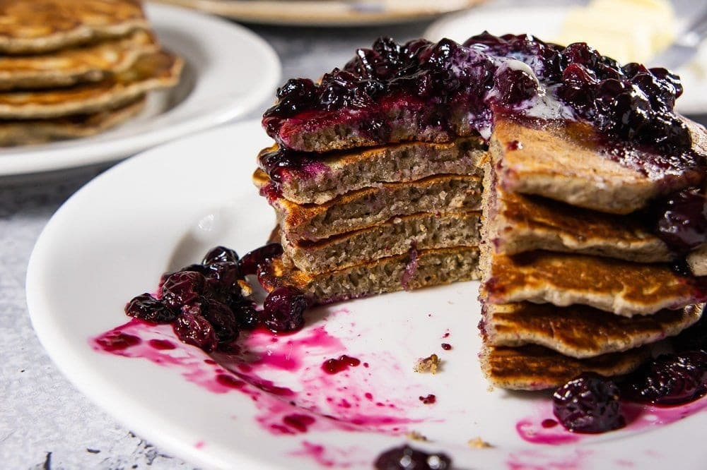 a cut open stack of buckwheat pancakes