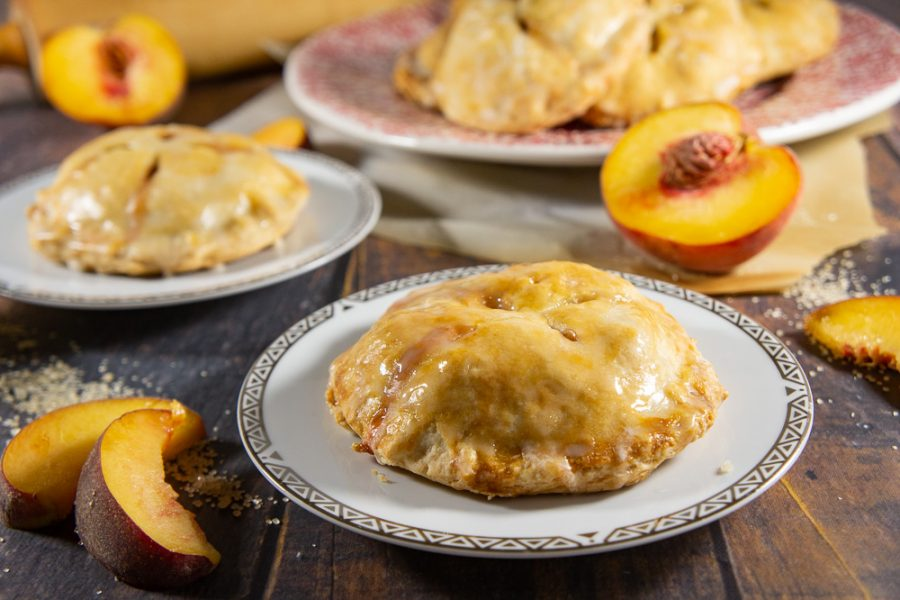 two peach hand pies and fresh peaches