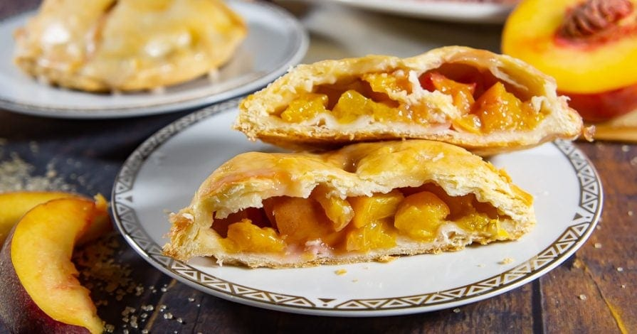 a mini peach pie cut open