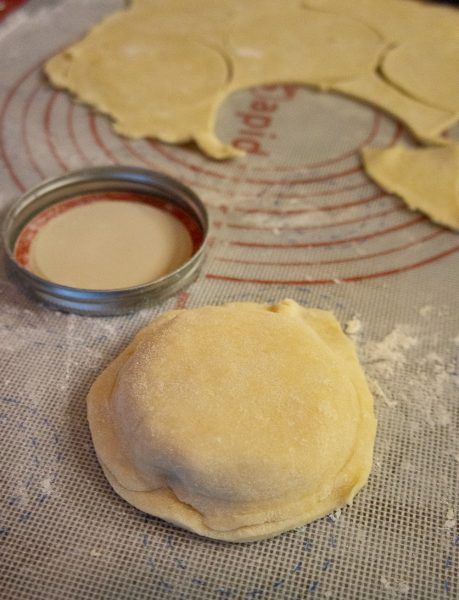 mini peach pie being formed