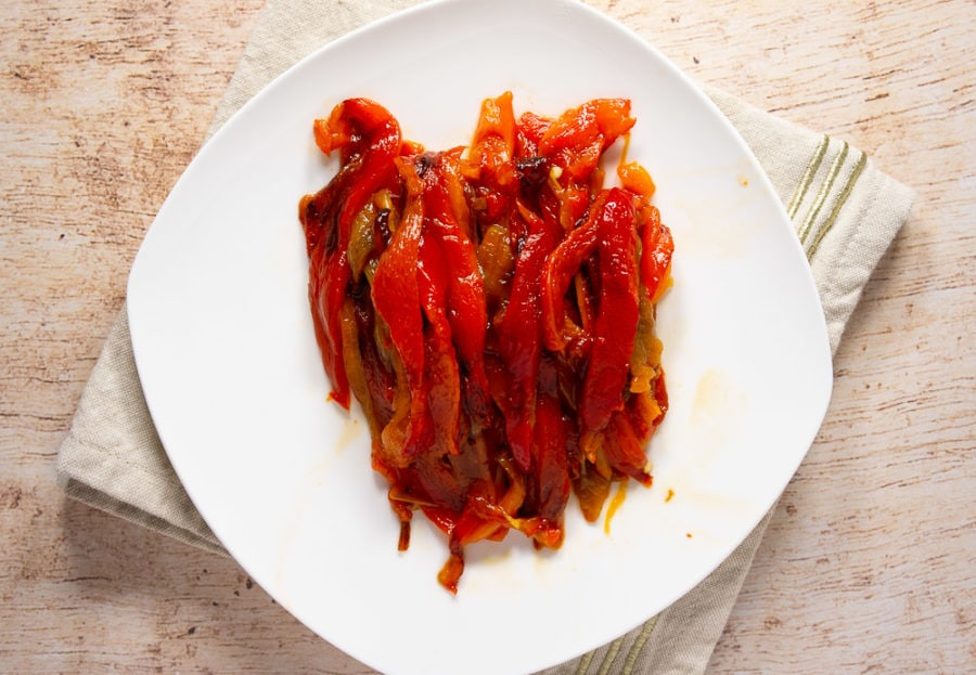 white plate of sliced roasted red peppers