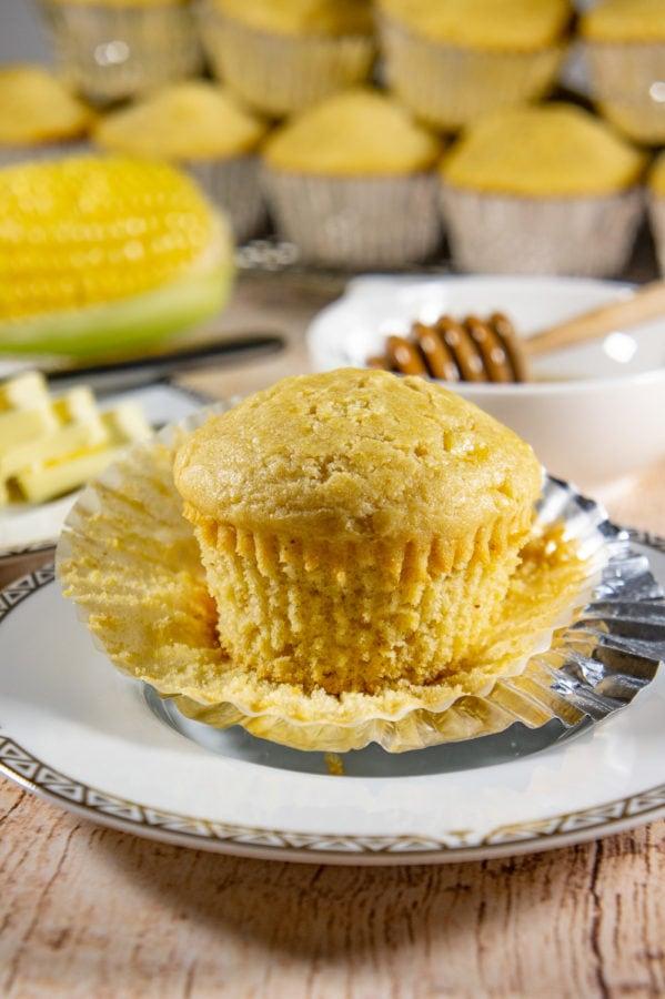 unwrapped cornbread muffin on a plate
