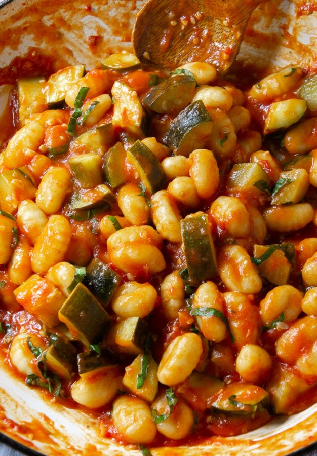 gnocchi with zucchini in a tomato sauce in a pan