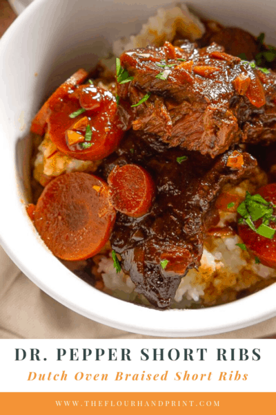 a white bowl of tender braised beef with carrots and grits