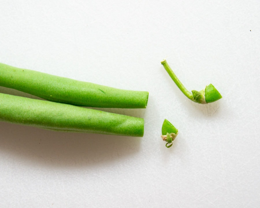 two green beans with the stems cut off