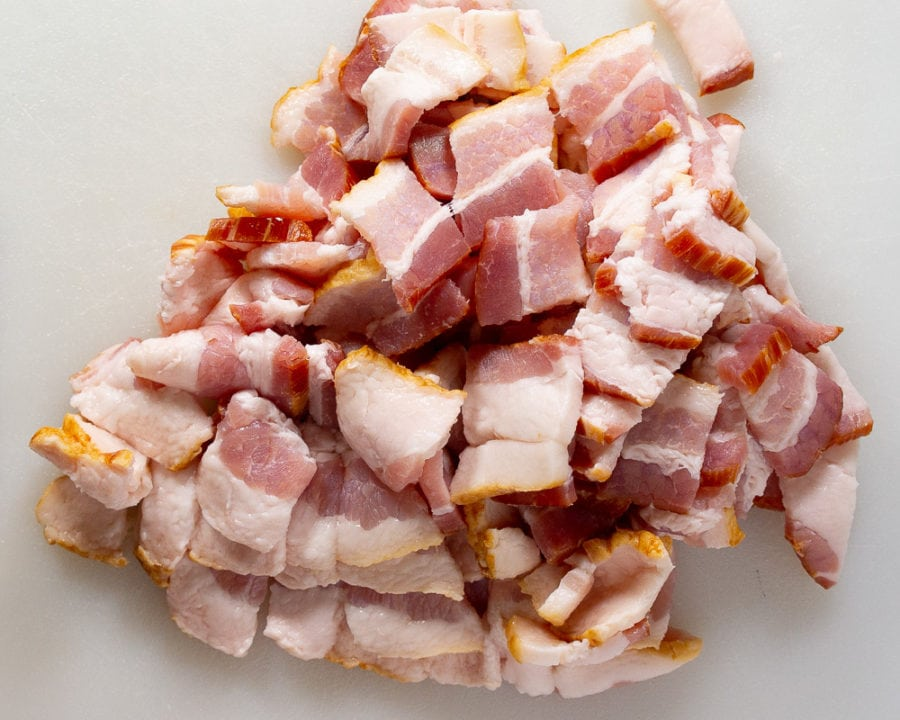 chopped bacon on a white cutting board