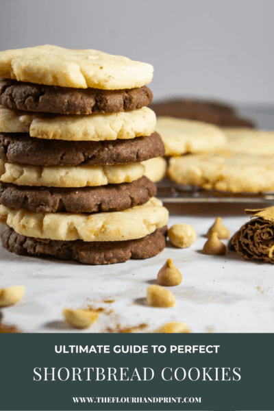 a stack of differently flavored shortbread cookies on a white granite counter