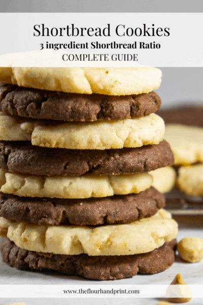a stack of differently flavored shortbread cookies in front of a metal cooling rack with more cookies