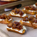 bacon jam crostinis on a serving tray