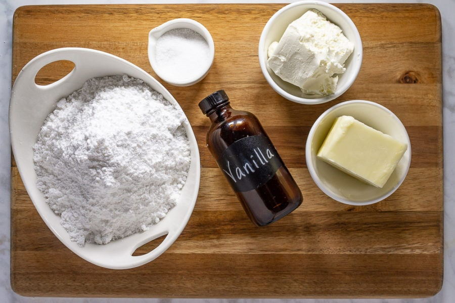 a bowl of powdered sugar, softened butter, softened cream cheese, vanilla extract, and a pinch of salt