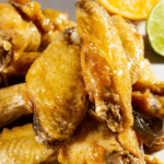 tequila lime wings on a parchment sheet