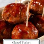 a platter of raspberry glazed meatballs on toothpicks