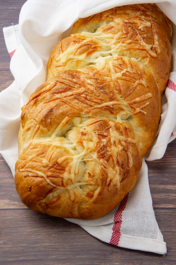 a loaf of braided Asiago cheese bread