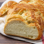 a sliced loaf of asiago bread