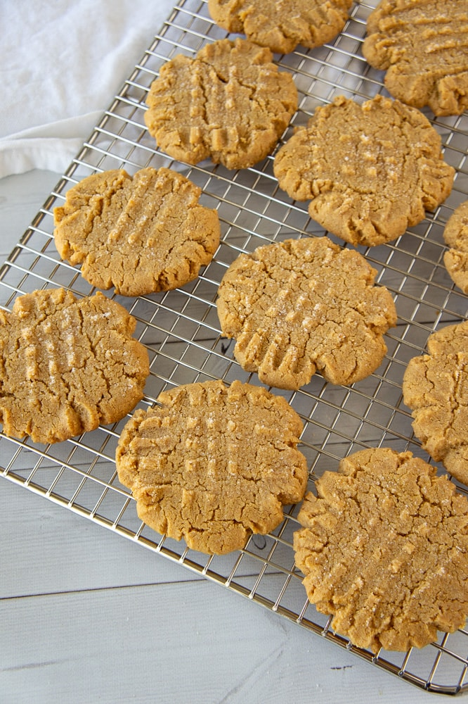 a cooling rack of peanut butter cookies