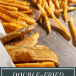 three cones of french fries on a wooden table