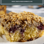 a slice of blackberry coffee cake on a white plate
