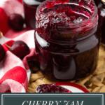 a jar of cherry vanilla jam on a wicker mat