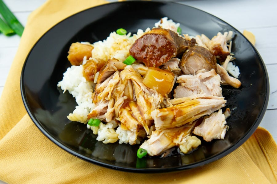 a plate of pineapple pulled pork with rice