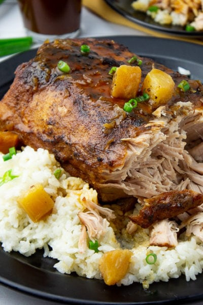 crockpot pineapple pork loin shredded on a platter with rice and sauce