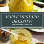 a jar of maple mustard vinaigrette over a jar of the dressing with a spoon drizzling it out