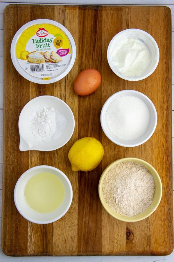 bowls with flour, oil, sugar, lemon, yogurt, and baking powder