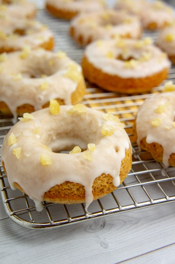 a cooling rack with lemon donuts glazed on it