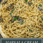 a pot of marsala cream sauce pasta with spinach and mushrooms