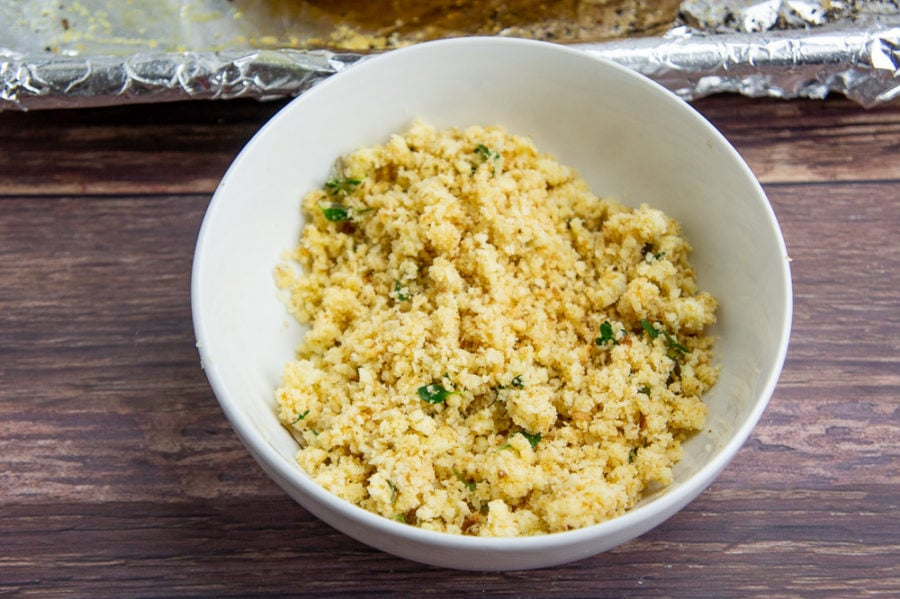 a bowl of breadcrumbs, thyme, and grated cheese