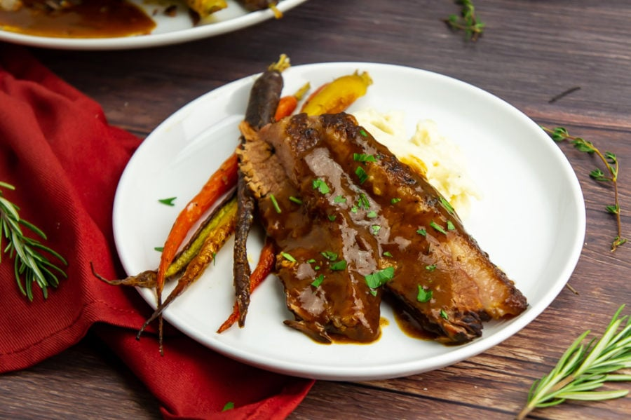 Sliced brisket with red wine gravy and carrots