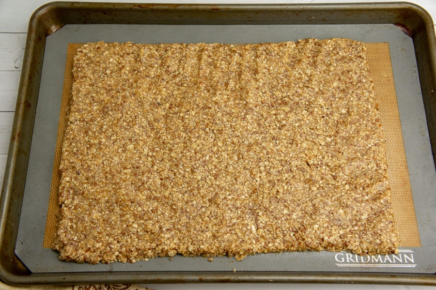 pecan granola bars shaped before baking on a sheet pan