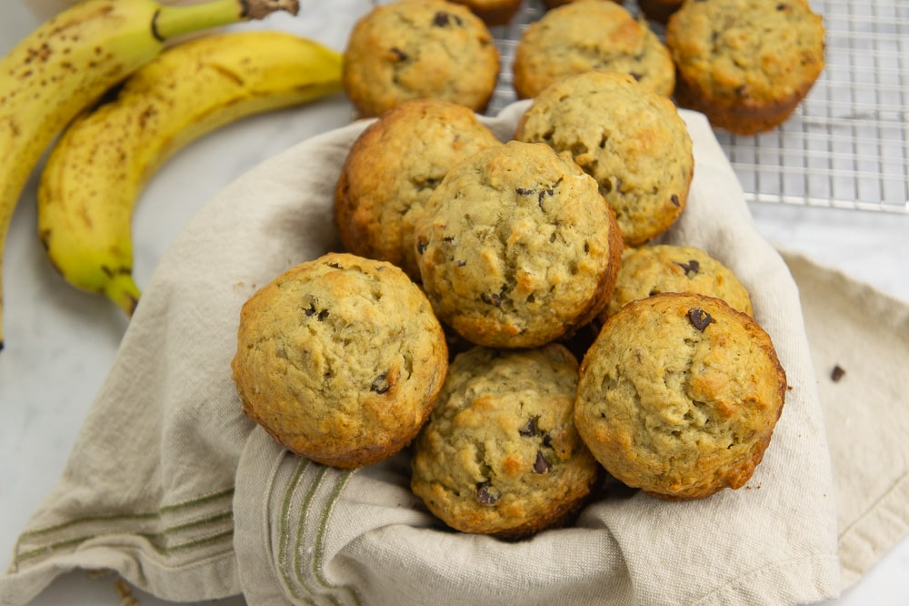 a bowl piled with banana oat muffins