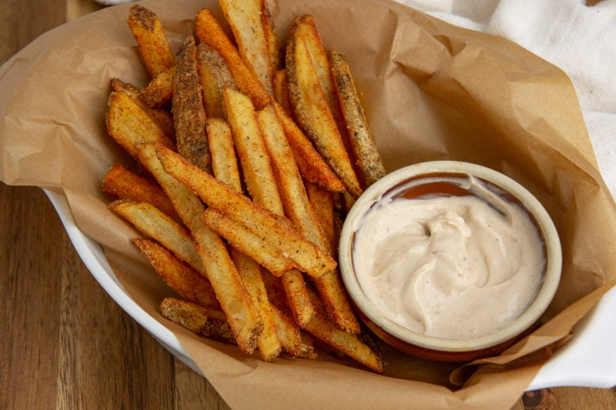 a basket of cajun fries with aioli