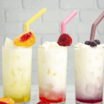 three Italian cream sodas in yellow, red, and purple