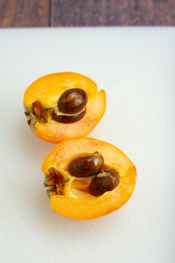 a loquat split in half